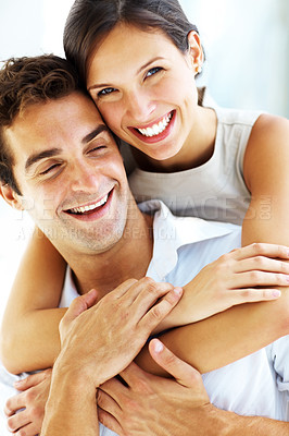 Buy stock photo Closeup of cute young female hugging her boyfriend from behind and smiling