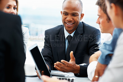 Buy stock photo Executive sharing business idea with colleagues