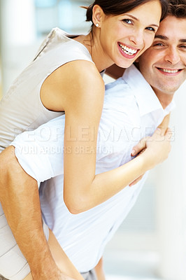 Buy stock photo Portrait of smiling young love couple piggybacking
