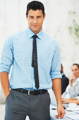 Buy stock photo Portrait of smart business man with colleagues sitting in background