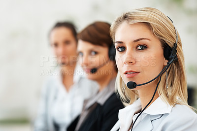 Buy stock photo Closeup of beautiful customer service representative with colleagues in background