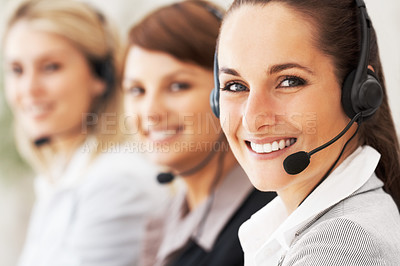 Buy stock photo Closeup of customer service representative with colleagues in background