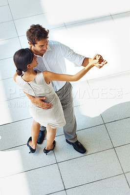 Buy stock photo Top view of happy young man and woman couple dancing and holding hands