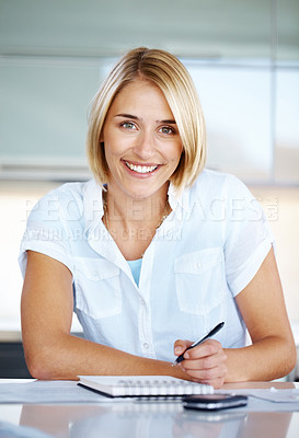 Buy stock photo Portrait of a pretty young lady taking notes in a notepad - at office