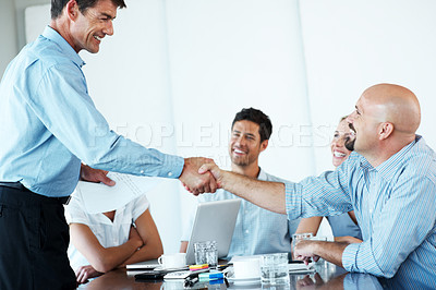Buy stock photo Portrait of a smart businessman appreciating his business colleague in a meeting at office