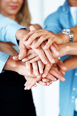 Buy stock photo Teamwork - Business partners hands on top of each other symbolizing  companionship and unity