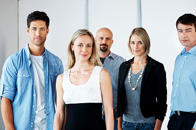 Buy stock photo Portrait of a pretty young lady standing with her business colleagues - Unity