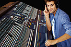 Sound studio - Young man working on sound mixer console