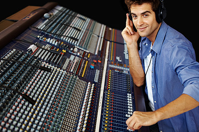 Buy stock photo Handsome young man in sound studio working with sound mixer console