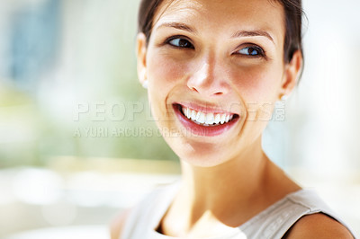 Buy stock photo Closeup portrait of attractive young woman smiling and looking away