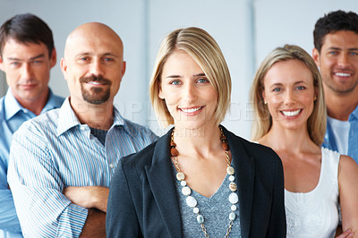 Buy stock photo Portrait of a stylish young businesswoman with her successful business team at office
