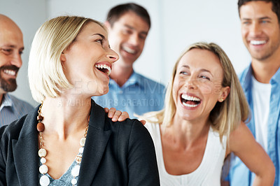 Buy stock photo Portrait of a successful young business group smiling together at office