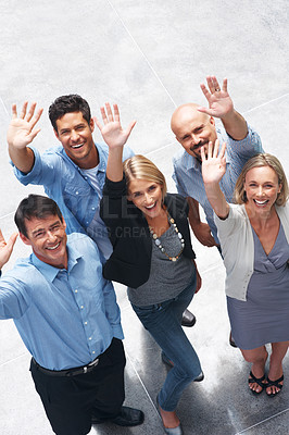Buy stock photo Portrait of happy business people waving hands and smiling