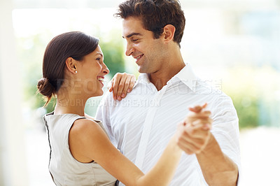 Buy stock photo Portrait of beautiful young romantic couple dancing together outdoors