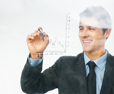 Buy stock photo Happy businessman drawing a chart to represent his company's growth