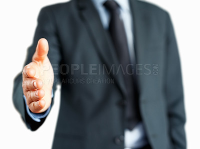 Buy stock photo Man in suit extending his hand to shake