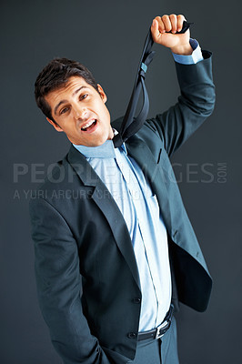 Buy stock photo Male executive strangling himself with necktie
