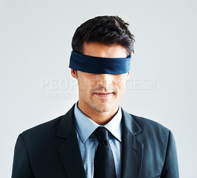 Buy stock photo Male executive with blindfold on, isolated on a white background