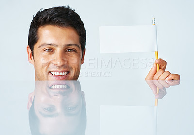 Buy stock photo Executive holding white flag while crouched down behind table