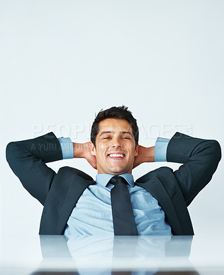 Buy stock photo Business man sitting in chair with hands behind his head