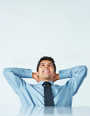 Buy stock photo Man in shirt and tie leaning back in chair with hands behind his head