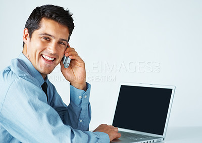 Buy stock photo Happy business man on cell phone in front of laptop