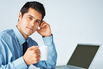 Buy stock photo Man in shirt and tie holding coffee cup sitting by laptop