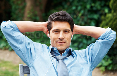 Buy stock photo Closeup of executive leaning back with hands behind head