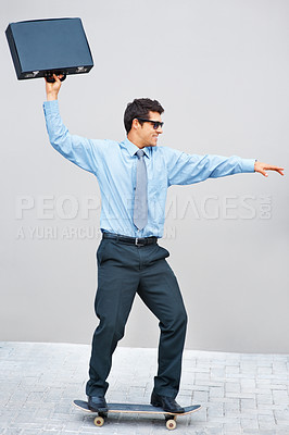 Buy stock photo Confident executive on skateboard outdoors