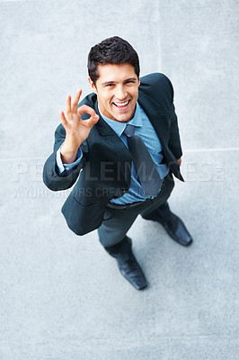 Buy stock photo Top view of businessman outside, giving ok sign