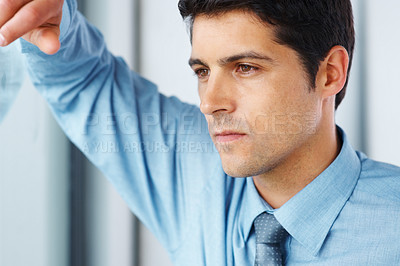 Buy stock photo Closeup of businessman looking out window