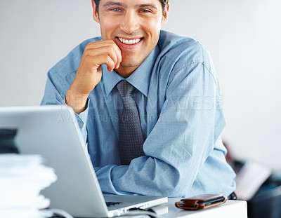 Buy stock photo Closeup view of friendly businessman sitting in front of laptop