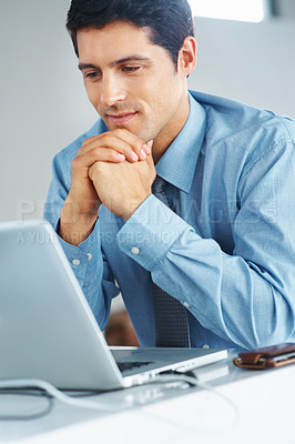Buy stock photo Happy business man viewing proposal on laptop