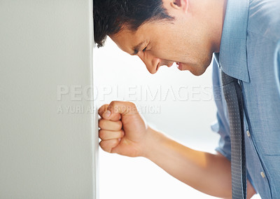 Buy stock photo Closeup of businessman leaning his head and fist against wall