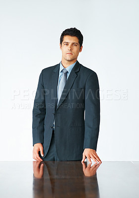Buy stock photo Executive standing near board room table