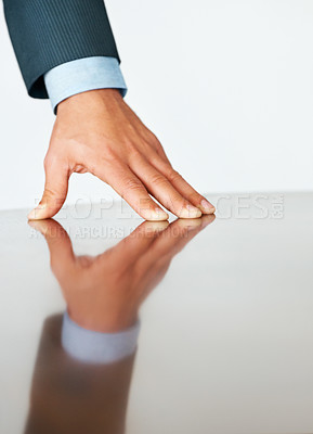 Buy stock photo Closeup of executive hand on board room table