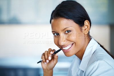 Buy stock photo Portrait of pretty woman holding pen up to face
