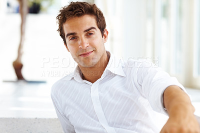 Buy stock photo Portrait of a casual young satisfied man sitting on steps