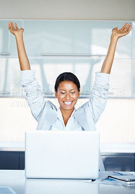 Buy stock photo View of woman at desk with arms thrown up, while looking at laptop