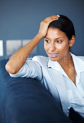 Buy stock photo View of pretty woman sitting on sofa indoors