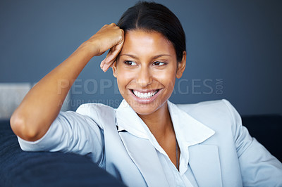 Buy stock photo View of pretty woman sitting on sofa and resting head on hand