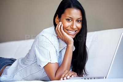 Buy stock photo Pretty woman lying on sofa with laptop computer