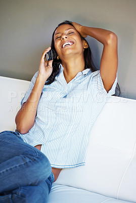 Buy stock photo Attractive woman on phone laughing while holding hand to head