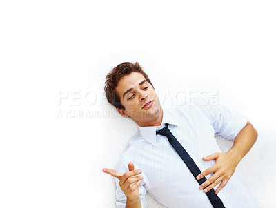 Buy stock photo Top view of young businessman lying on floor and pointing at copyspace