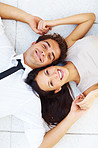Young couple on floor with heads together