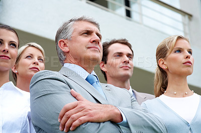Buy stock photo Team of satisfied business people looking at their bright future - Successful business team