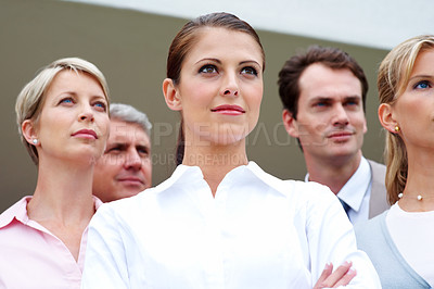 Buy stock photo Closeup of female business woman with supporting team looking away