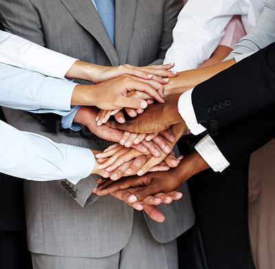 Buy stock photo Cropped image of a group of businesspeople with their hands joined together