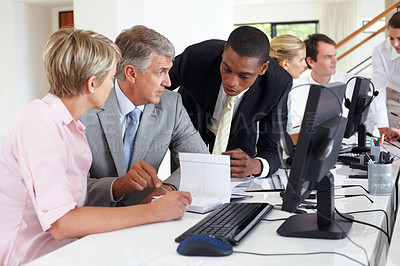 Buy stock photo Senior business man discussing work with his colleagues during a meeting at office
