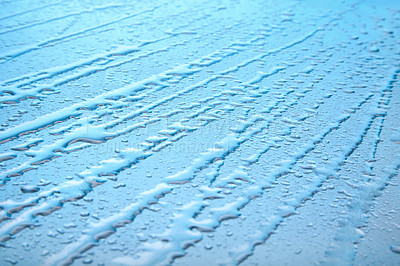 Buy stock photo View of diagonal water drops in row against blue